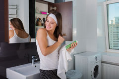 Woman in the bathroom. Beautiful woman choosing beauty products in her bathroom in the morning Stock Photography