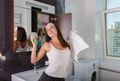 Woman in the bathroom. Beautiful woman choosing beauty products in her bathroom in the morning Royalty Free Stock Photography