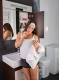 Woman in the bathroom. Beautiful woman choosing beauty products in her bathroom in the morning Royalty Free Stock Images