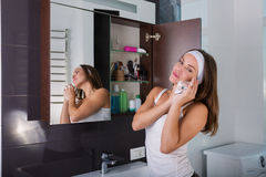 Woman in the bathroom. Beautiful woman choosing beauty products in her bathroom in the morning Royalty Free Stock Image