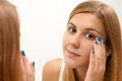Woman in the bathroom Royalty Free Stock Images