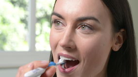 Woman In Bathroom Brushing Teeth With Manual Toothbrush stock video footage