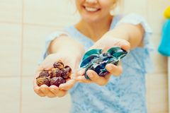 Woman show soap nuts and gel pods detergent stock photo