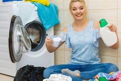 Girl doing laundry choose best detergent stock image