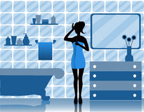 Woman in bathroom Royalty Free Stock Photos