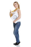 Woman with bathroom scale and measuring tape Stock Photo