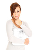 Woman with bathroom scales Stock Image