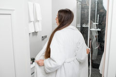 Woman in the bathroom Stock Photography