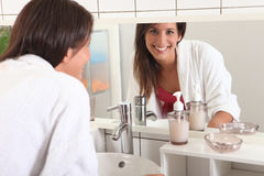 Woman in the bathroom Royalty Free Stock Photography