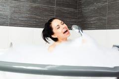 Woman at bathroom. Young girl taking bath Stock Image