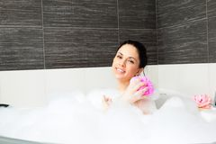 Woman at bathroom Royalty Free Stock Image