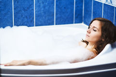 Woman in bathtub. A beautiful woman in bathtub Royalty Free Stock Photos