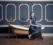 Woman on  bathtub. Woman , sitting on the vintage bathtub (photo compilation Royalty Free Stock Image
