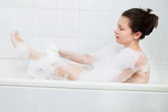 Woman in bathtub Stock Image