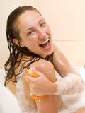 Woman in bathtub Stock Image