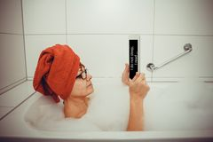 Woman in bathtub with tablet computers, retro style Royalty Free Stock Photography