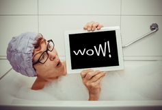 Woman in bathtub with tablet computers, retro style. Space for text stock images