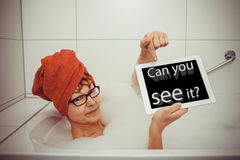 Woman in bathtub with tablet computers, space for text Royalty Free Stock Photography