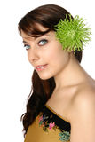 Woman in batik wrap with green gerbera in her hair Stock Images