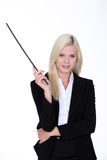Woman with baton in hand Royalty Free Stock Photos