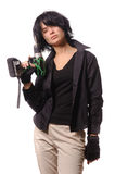 Woman with battery drill in black casual clothing royalty free stock image