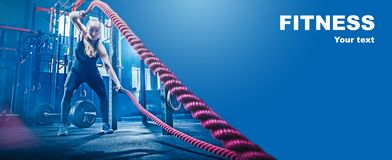 Woman with battle rope battle ropes exercise in the fitness gym. stock photos