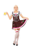 Woman in Bavarian costume holding a pint of beer royalty free stock photo