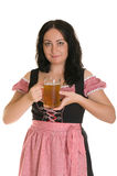 The woman in Bavarian dress with a beer Stock Images