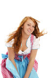 Woman in bavarian dress handling with wind Stock Image