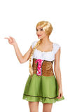 Woman in Bavarian dress pointing aside. Stock Image
