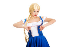 Woman in Bavarian dress with thumbs down. Royalty Free Stock Photo