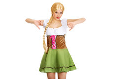 Woman in Bavarian dress with thumbs down. Stock Photo