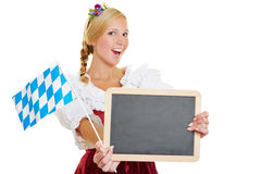 Woman with bavarian flag and blackboard Royalty Free Stock Photo