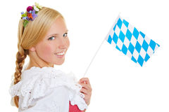 Woman with bavarian flag and dirndl Royalty Free Stock Photography