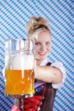 Woman in Bavarian outfit with beer Royalty Free Stock Photo