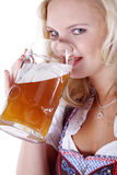 Woman in Bavarian outfit with beer Royalty Free Stock Photos