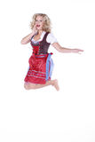 Woman in Bavarian outfit and jumps Royalty Free Stock Images