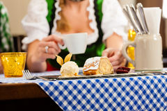 Woman in Bavarian Tracht in restaurant or pub Royalty Free Stock Photography