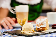 Woman in  Bavarian Tracht in restaurant or pub Royalty Free Stock Image