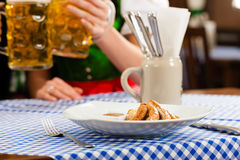 Woman in Bavarian Tracht in restaurant or pub Royalty Free Stock Images