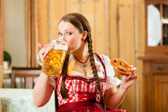 Woman in Bavarian Tracht in restaurant or pub Stock Image
