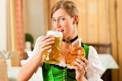 Woman in Bavarian Tracht in restaurant or pub Stock Photos
