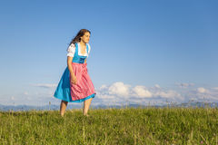Woman in bavarian traditional dirndl Stock Images