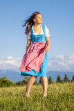 Woman in bavarian traditional dirndl Stock Photography