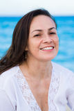 Woman on the beach. Beautiful adult woman in the 40's on the beach royalty free stock image