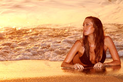 Woman by beach Stock Photos