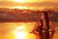 Woman by beach Stock Photo