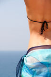 Woman on the beach. Woman in bikini and sarong on the beach Royalty Free Stock Photos