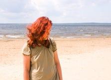 Woman on a beach. Sad woman on a beach Stock Photo