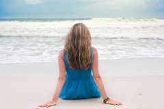 Woman on beach. Attractive young woman beach with surf in background Royalty Free Stock Photography